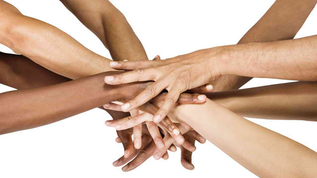 hands of varying races coming together